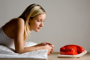 Teenager looking at red phone